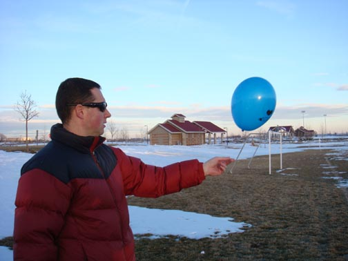 Dad releasing the balloon at the Sports Park